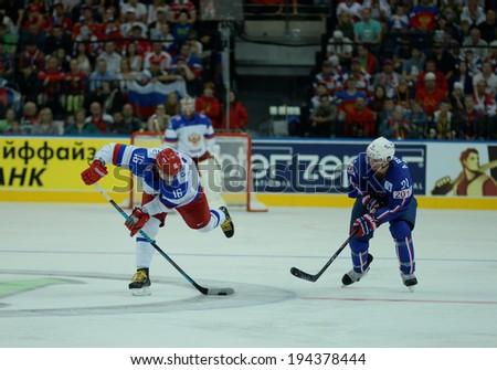MINSK, BELARUS - MAY 22: PLOTNIKOV Sergei of Russia shoot the puck during 2014 IIHF World Ice Hockey Championship quarterfinal match on May 22, 2014 in Minsk, Belarus.