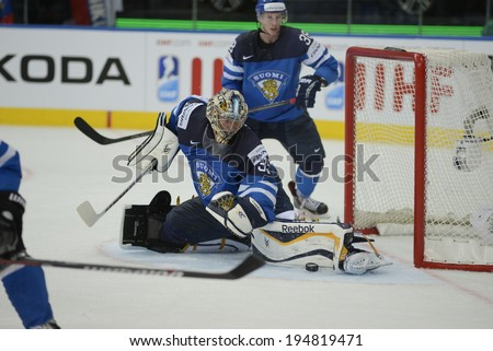 MINSK, BELARUS - MAY 25: RINNE Pekka (35) of Finland saves the puck during 2014 IIHF World Ice Hockey Championship final at Minsk Arena