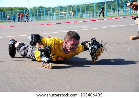 MINSK,BELARUS - MAY 19:Sasha Popelsky, instructor FSK, put roller Skates on hands during School Roller Cup 2012 - Stage 1 (FSK) on May 19, 2012 in Minsk, Belarus. - stock photo