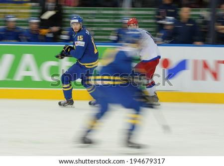 MINSK, BELARUS - MAY 24: SJOGREN Mattias(15) of Sweden skates up the ice during 2014 IIHF World Ice Hockey Championship semifinal match at Minsk Arena on May 24, 2014 in Minsk, Belarus.