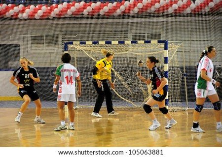 MINSK, BELARUS - MAY 30: Unidentified handball players (Germany(black) score during European Championship qualifying match (Belarus Germany) on May 30, 2012 in Minsk, Belarus.