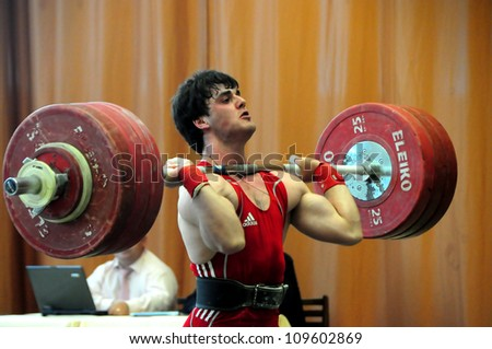 MINSK BELARUS MAY 31 Unidentified sportsman is trying to take the weight during Belarus Open Championship in weightlifting on May 31 2012 in Minsk Belarus
