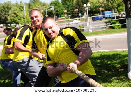 MINSK, BELARUS - MAY-19: Unidentified sportsmen compete in tug of war during NATIONAL DAY of SPORT on May 19, 2012 in Minsk, Belarus.