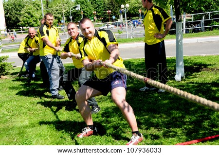 MINSK, BELARUS - MAY 19: Unidentified sportsmen compete in tug of war during NATIONAL DAY of SPORT on May 19, 2012 in Minsk, Belarus.
