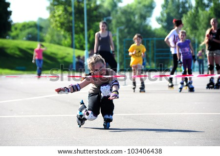 MINSK,BELARUS -MAY 19: Unidentified young girl competes in Down Ride (riding under bar) during School Roller Cup 2012 - Stage 1 (FSK) on May 19, 2012 in Minsk, Belarus. - stock photo
