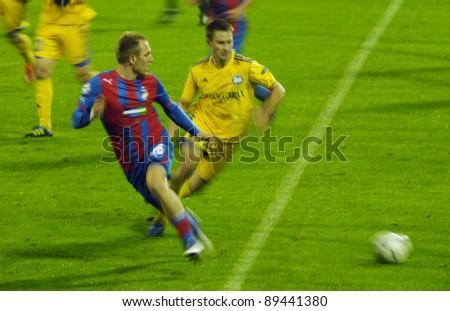 MINSK, BELARUS - NOVEMBER 23: Daniel Kolar(L) of FC Viktoria vies for the ball with Maksim Skavysh(R) of FC BATE during their UEFA Champions League match on November 23, 2011 in Minsk, Belarus