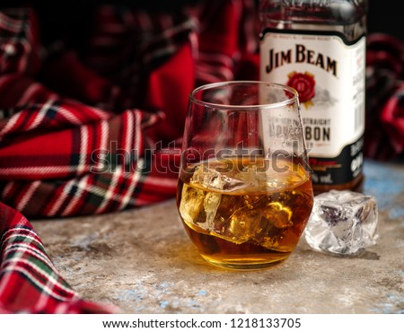 MINSK, BELARUS - OCTOBER 31, 2018: Bottle and glass Jim Beam is one of best selling brands of bourbon in the world, produced by Beam Inc. in Clermont, Kentucky