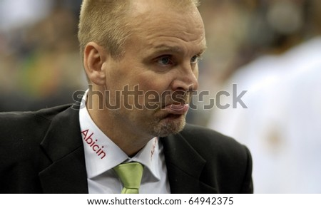 MINSK, BELARUS - OCTOBER 19: Pekka Salminen - head coach of BC Honka watches the game with BC Minsk-2006 in VTB United League game on October 19, 2010 in Minsk, Belarus