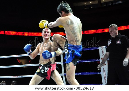 MINSK, BELARUS-SEPT. 12: Andrej Kulebin of Belarus (left) VS Sudsakorn Klinmi of Asia (right) in final fight of BIG8 MUAY-THAY CHAMP in Minsk, Belarus on September 12, 2010