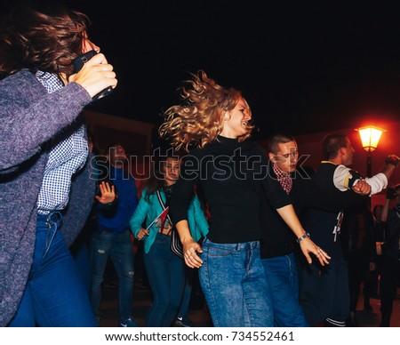 MINSK, BELARUS.September16,2017. A group of people dancing at a street concert