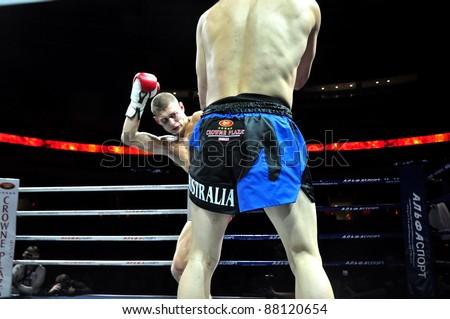 MINSK, BELARUS-SEPTEMBER 12:Andrej Kulebin(kicking) Belarus VS Taylor Harvey(right) Australia fighting at BIG8 MUAY-THAY CHAMP in Minsk, Belarus on September 12, 2010