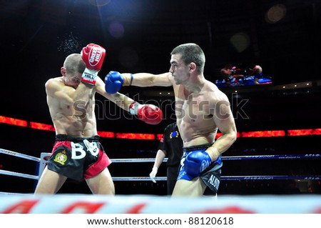 MINSK, BELARUS-SEPTEMBER 12:Andrej Kulebin(left) BelarusVS Taylor Harvey(right) Australia fight at the BIG8 MUAY-THAY CHAMP in Minsk, Belarus on September 12, 2010