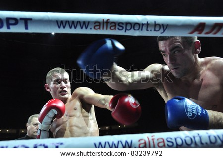 MINSK, BELARUS-SEPTEMBER 12: Kulebin(left)  BelarusVS Harvey(right)  Australia fighting at BIG8 MUAY-THAY CHAMP in Minsk, Belarus on September 12, 2010