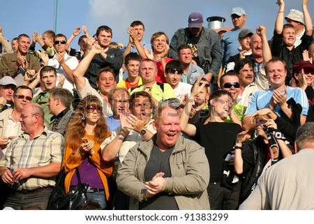 MINSK, BELARUS - SEPTEMBER 13: Match DYNAMO Minsk VS TORPEDO Jodino, unidentified soccer fans celebrating goal on September 13, 2009 in Minsk,  Belarus
