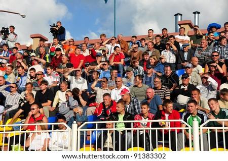 MINSK, BELARUS - SEPTEMBER 13: Match DYNAMO minsk VS TORPEDO Jodino, unidentified soccer fans watching match on September 13,2009 in Minsk, Belarus