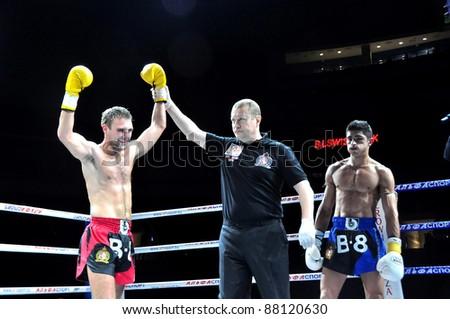 "MINSK, BELARUS-SEPTEMBER 12:Ruslan Kushnirenko (left) Ukraine wins over Marcos "" El Indio "" Cornejo South America at the BIG8 MUAY-THAY CHAMP in Minsk, Belarus on September 12, 2010"