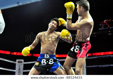 MINSK, BELARUS-SEPTEMBER 12:. Sudsakorn Klinmi (L) VS Ruslan Kushnirenko of Ukraine at BIG8 MUAY-THAY CHAMP in Minsk, Belarus on September 12, 2010