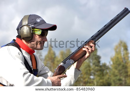 MINSK, BELARUS-SEPTEMBER 25: Unidentified sportsman concentrates before shooting at the open of the 2011 Belarussian Championship  Sporting on September 25, 2011 in Minsk, Belarus.