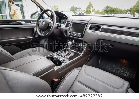 MINSK, BELARUS - SEPTEMBER 20, 2016: VW Touareg at the test-drive event. Touareg offers true 4x4 capabilities off-road, and a smooth ride on it. Photo of the interior. #489222382