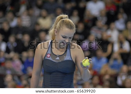 MINSK - NOVEMBER 19: Denmark's tennis star Caroline Wozniacki  gets ready to serve the ball during a charitable tennis match in Minsk, Belarus, on November 19, 2010