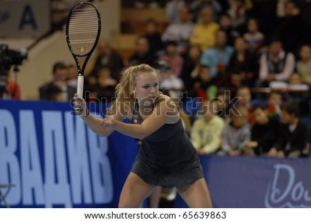 MINSK - NOVEMBER 19: Denmark\'s tennis star Caroline Wozniacki plays during their charitable tennis match  in Minsk, Belarus, on November 19, 2010