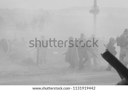 MINSK, REPUBLIC OF BELARUS - JULY 2, 2018: Military combat reconfiguration, Operation Bagration during World War II Reconstructors German and Russian soldiers, equipment on the battlefield. #1131919442