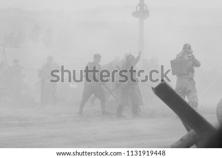 MINSK, REPUBLIC OF BELARUS - JULY 2, 2018: Military combat reconfiguration, Operation Bagration during World War II Reconstructors German and Russian soldiers, equipment on the battlefield. #1131919448
