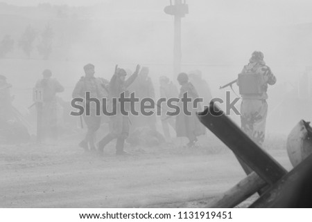 MINSK, REPUBLIC OF BELARUS - JULY 2, 2018: Military combat reconfiguration, Operation Bagration during World War II Reconstructors German and Russian soldiers, equipment on the battlefield. #1131919451