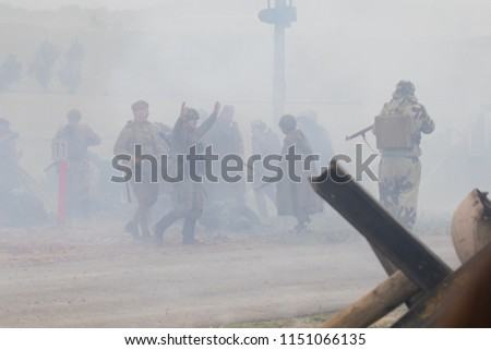 MINSK, REPUBLIC OF BELARUS - JULY 2, 2018: Military combat reconfiguration, Operation Bagration during World War II Reconstructors German and Russian soldiers, equipment on the battlefield. #1151066135