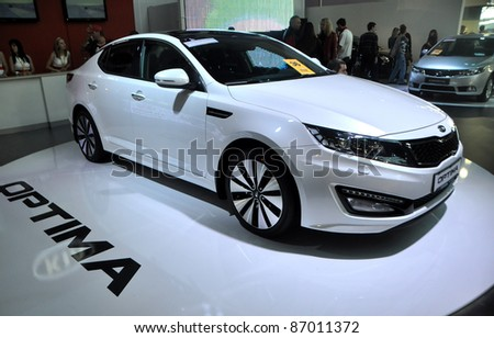 MINSK - SEPTEMBER 24: Kia Optima on display at the Minsk 2011 MOTORSHOW, an auto exhibition on September 24, 2011 in Minsk, Belarus.