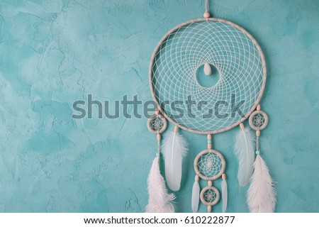 Mint cream dream catcher on turquoise textured background. Texture of concrete.  #610222877