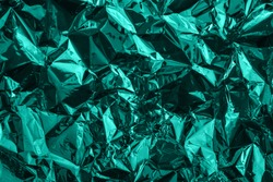 Mint green deformed cellophane or plastic. Creative background for your design