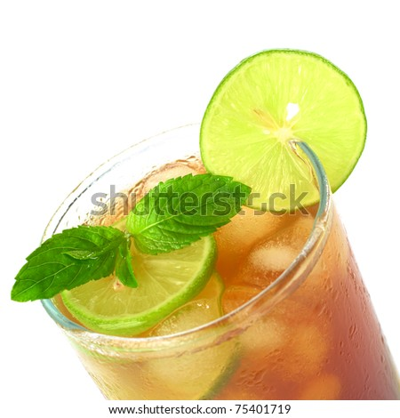 Mint leaf and lime slice on the top of iced tea (Selective Focus, Focus on the mint leaf and the lime slice on the glass rim)