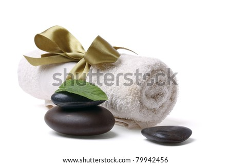 Mint leaves and stones near a rolled towel, isolated on white