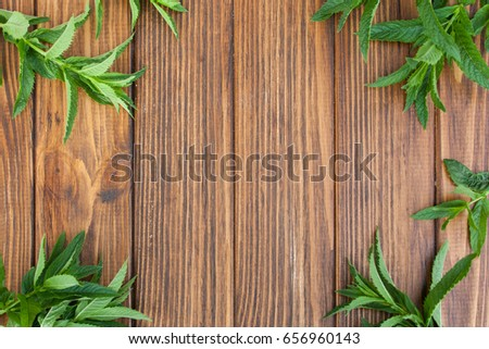 Mint leaves on a wooden background top view