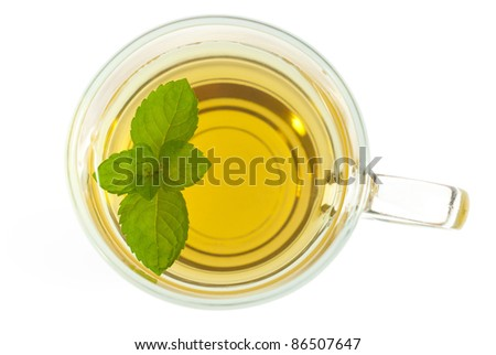 mint tea with leaves directly above, isolated on white