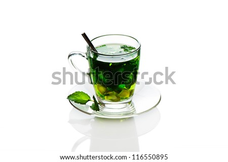 Mint tea with mint leaf and lemon in a glass cup om white background