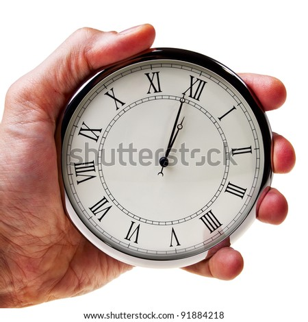 Minute to midnight or noon on retro watch hold in male hand isolated over white background.