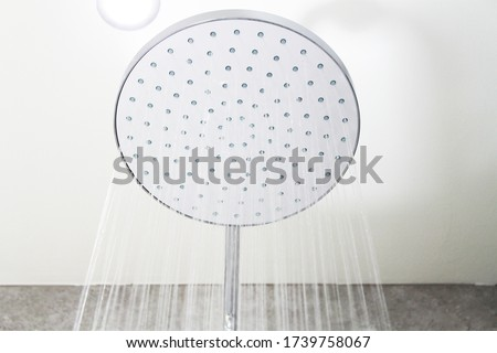 Mira shower head up close. Shower with running water Сток-фото ©