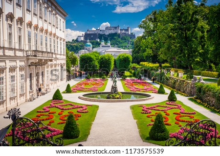 Mirabell Palace and Gardens in Summer, Salzburg castle in background - Shutterstock ID 1173575539