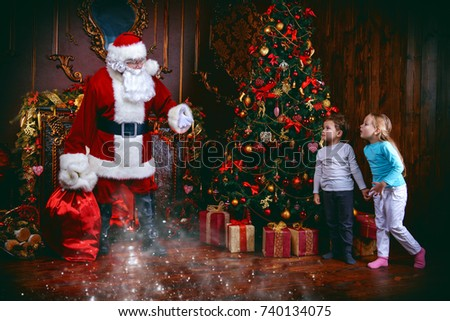 Miracles happen. Small children saw Santa Claus on Christmas eve. Christmas concept. #740134075
