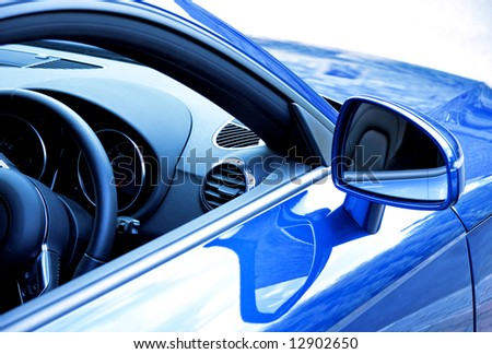 Mirror and dashboard on blue sports car