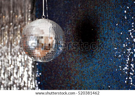 Mirror disco ball hanging from the ceiling.
