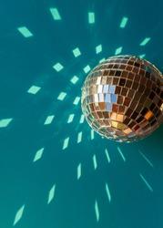 Mirror disco ball sun glare abstract blue background, banner, frame, postcard. Disco festive new year xmas winter theme.