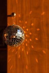 Mirror disco ball sun glare abstract orange background, banner, frame, postcard. Disco festive new year xmas winter theme.