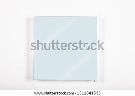 mirror framed on a minimal frame against a white background #1311841535