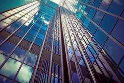mirror-glass skyscraper displaying the blue sky