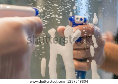 Mirror is cleaned with detergent #1239349804