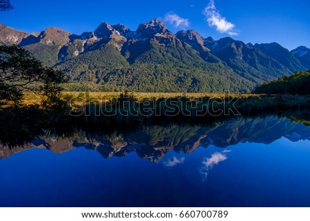 Mirror Lakes along the way to Milford Sound, New Zealand #660700789