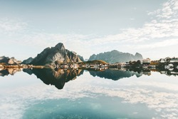 Mirror reflection at sea mountains and village Norway landscape Lofoten islands Travel scenery scandinavian nature
